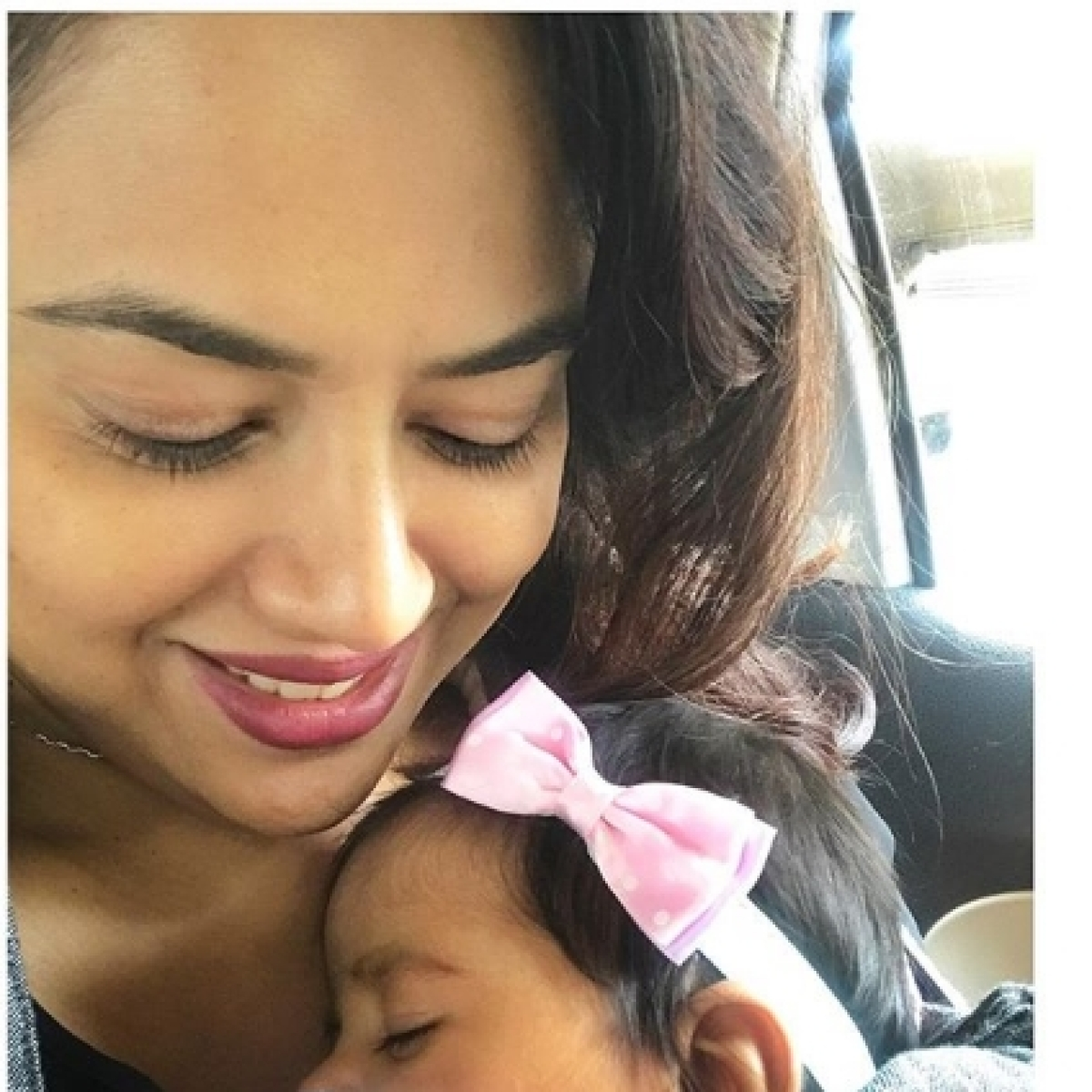 #Momgoals: Sameera Reddy walks 500 steps with her two month old daughter strapped on to her to reach Karnantaka's highest peak