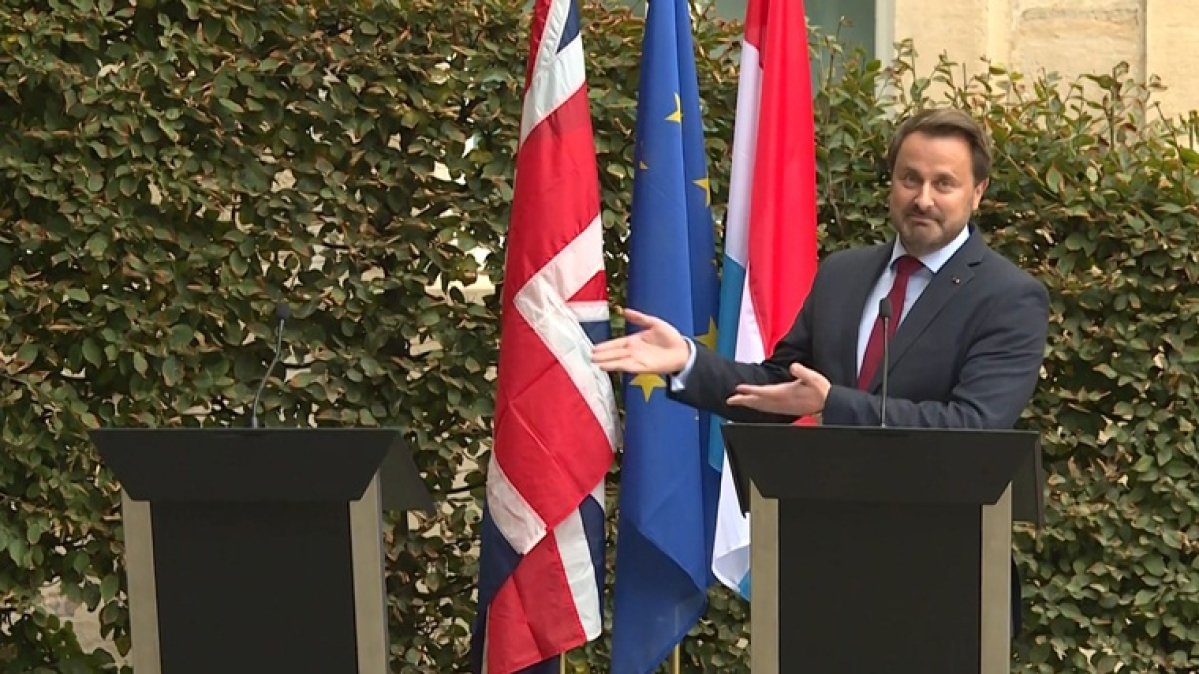 Luxembourg PM Xavier Bettel holds press meet next to empty podium after Boris Johnson fails to convince EU leaders on Brexit