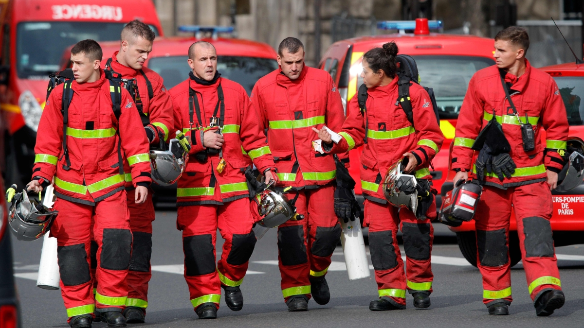Firefighters walk near Paris police  headquarters after four officers were killed in a knife attack