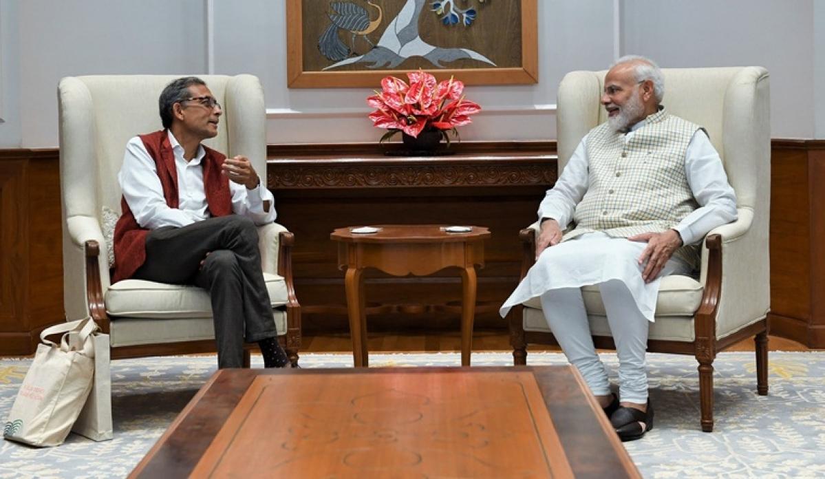 (from left) Nobel laureate Abhijit Banerjee and PM Modi