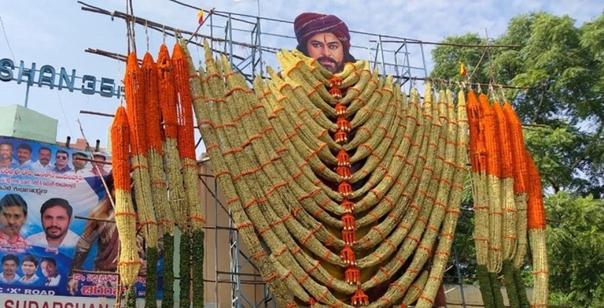 Fans garland cut-out of Chiranjeevi, as 'Sye Raa Narasimha Reddy' hits theatres