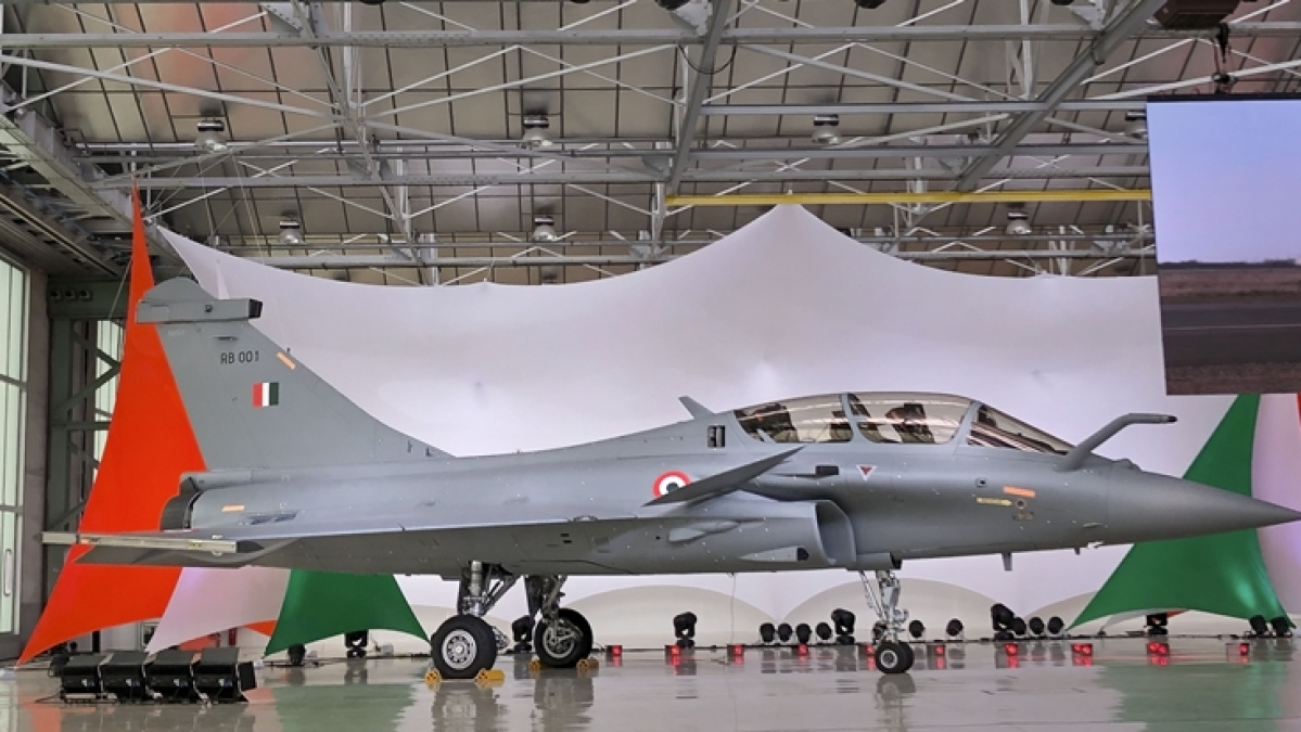 Defense Minister Rajnath Singh takes delivery of IAF's first Rafale fighter jet