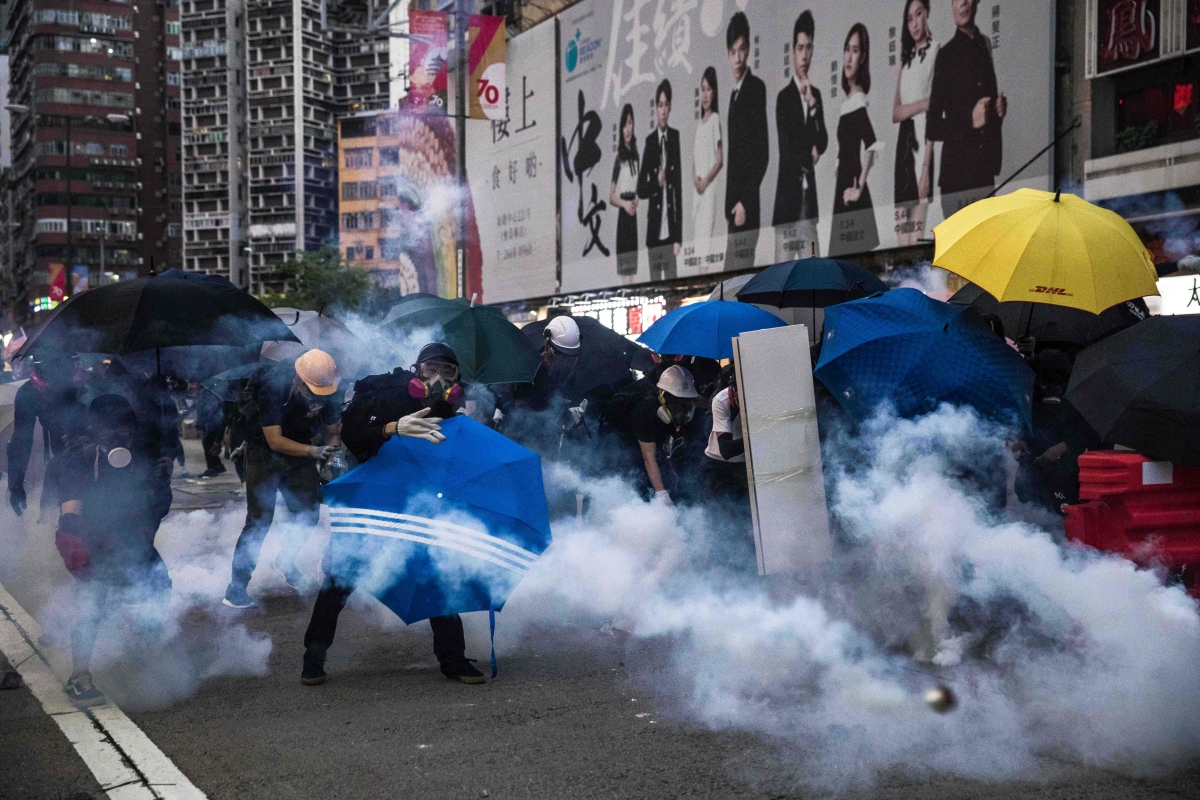 Hong Kong police fire tear gas as protesters defy ban