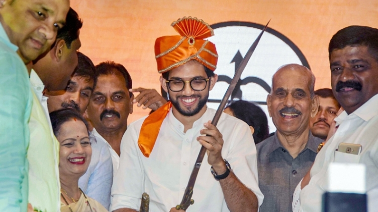 Mumbai: Yuva Sena chief Aaditya Thackeray, the elder son of party chief Uddhav Thackeray, presented with a sword as he announces his candidature from Worli seat for upcoming Maharashtra Assembly elections during a rally, in Mumbai, Monday, Sept. 30, 2019. Aaditya will become the first member of the Thackeray clan ever to contest an election. (PTI Photo) (PTI9_30_2019_000265B)