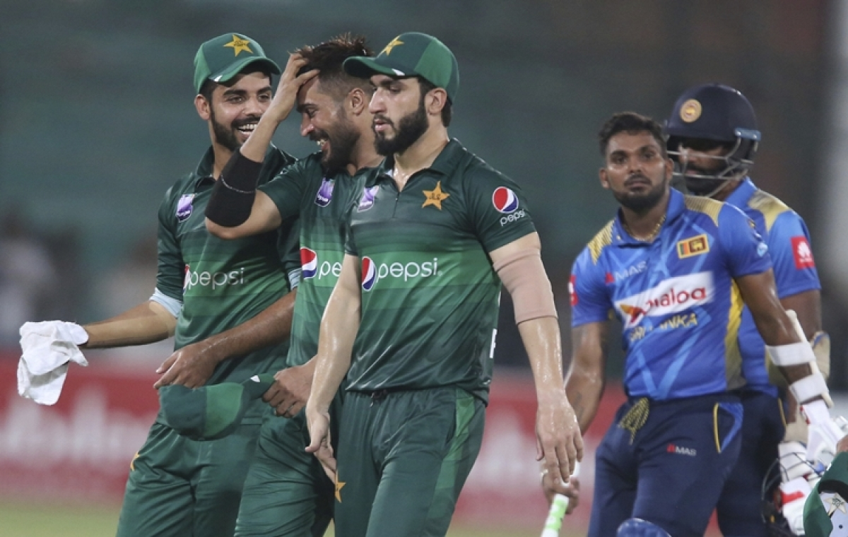 Pakistani players celebrate their victory against Sri Lanka in the second one-day international in Karachi, Pakistan.