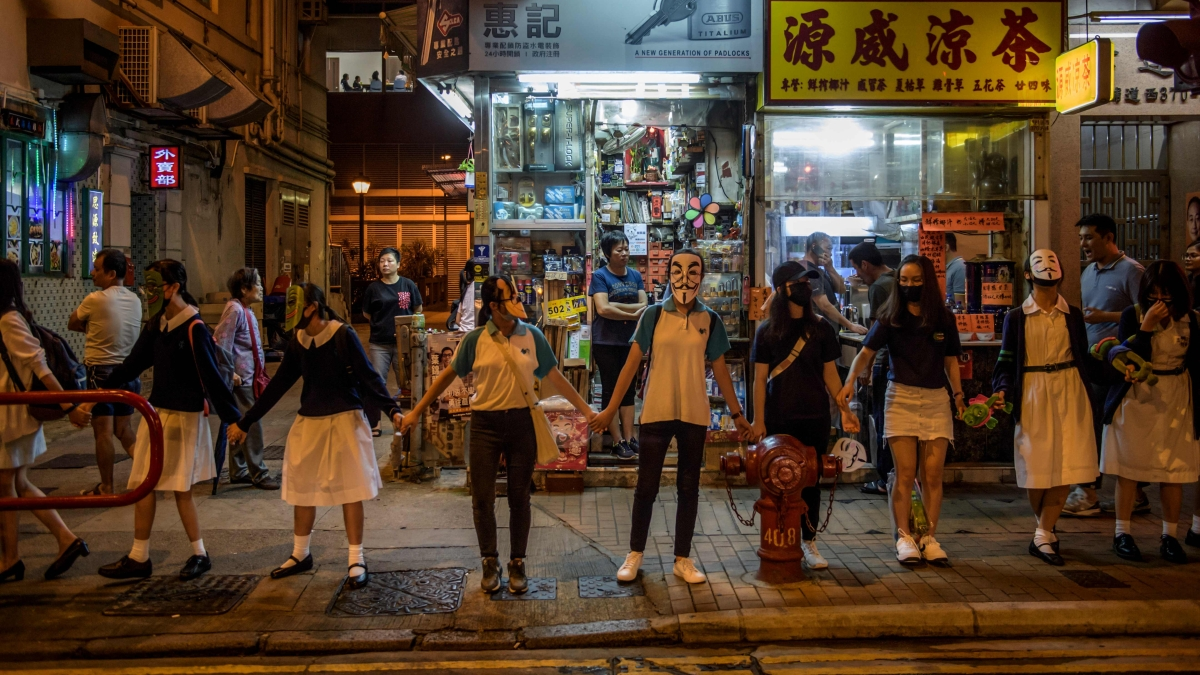 Hong Kong: Protestors march even as rally is banned