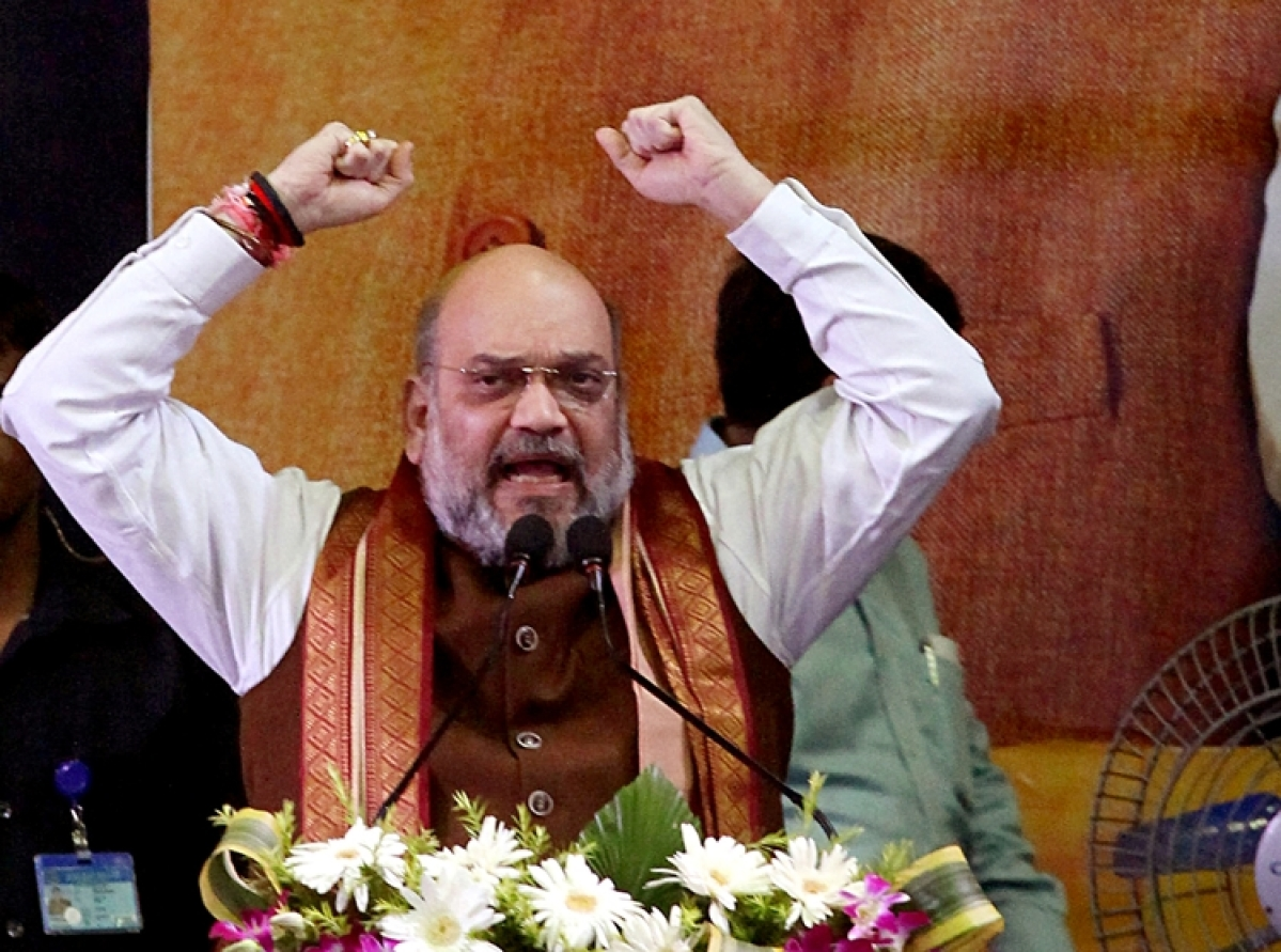 Union Home Minister Amit Shah addresses during the Jana Jagran Sabha at Netaji Indoor Stadium in Kolkata