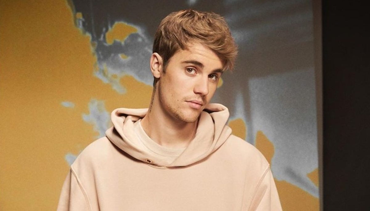 Justin Bieber is being sued for posting his own picture