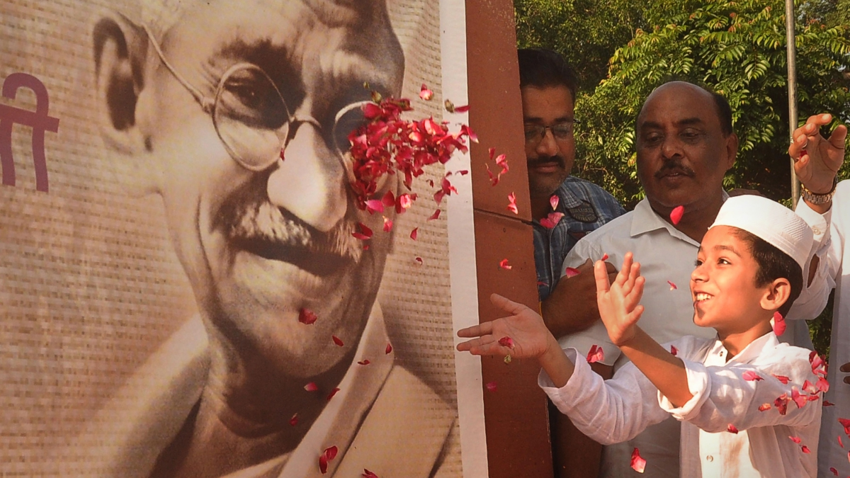 A child pays homage to Mahatma Gandhi to mark his 150th birth anniversary, in Amritsar.