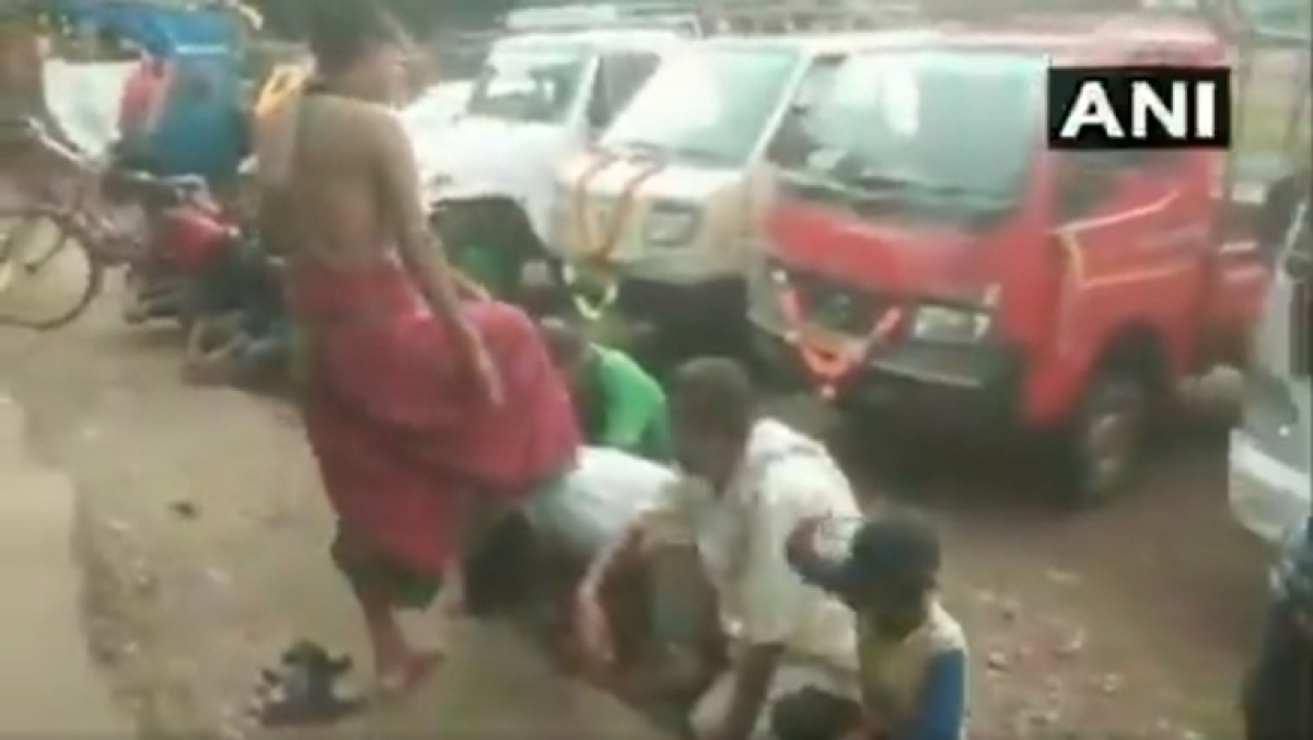 Watch: Odisha priest gives blessings to people by putting his foot on their heads