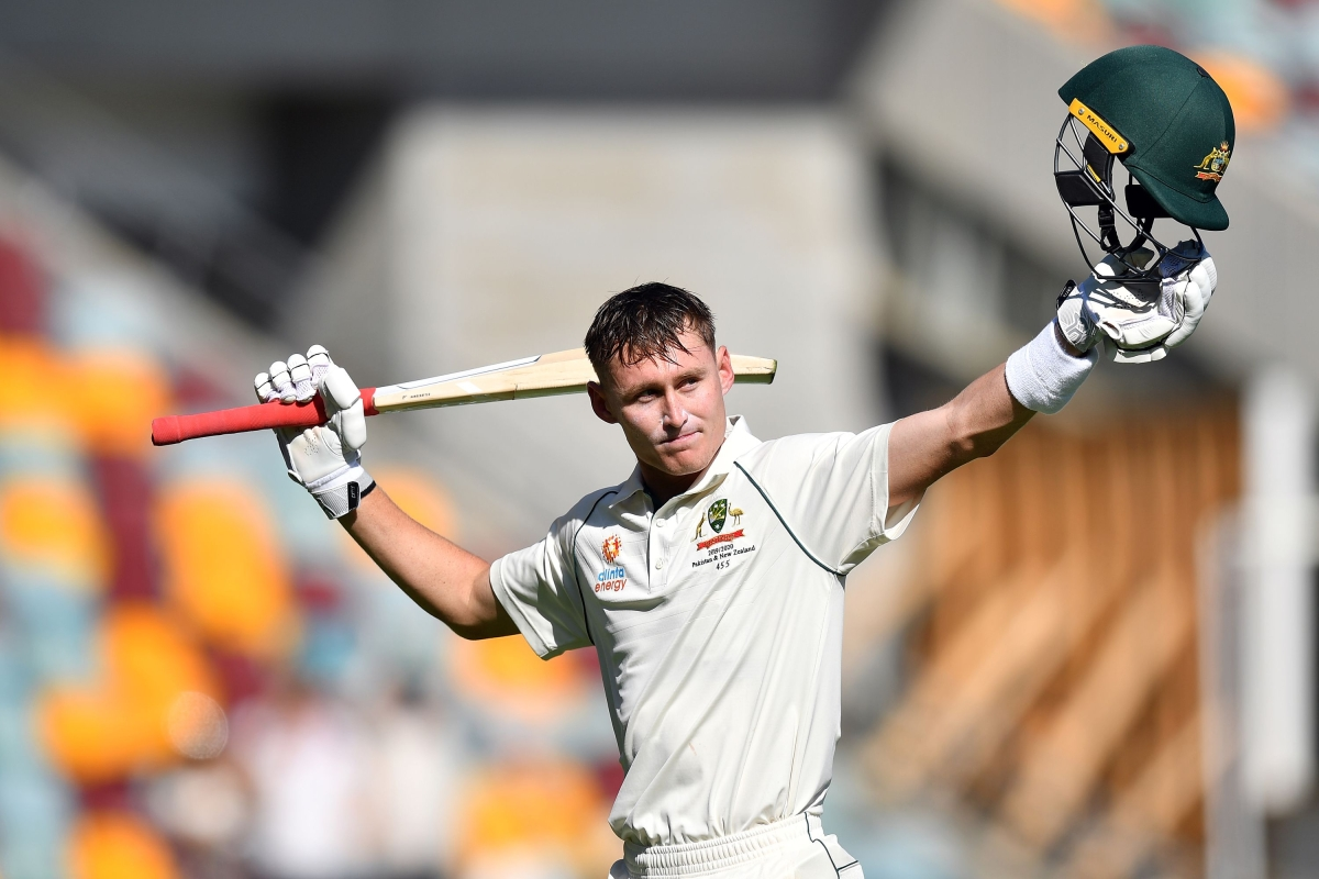 Australia's batsman Marnus Labuschagne waves as he walks back to the pavilion after his dismissal on 185 runs on day three of the first Test cricket match between Pakistan and Australia at the Gabba in Brisbane on November 23, 2019.