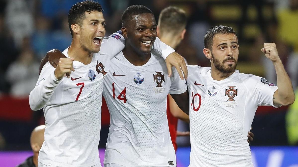Cristiano Ronaldo (left), William Carvalho (centre) and Bernardo Silva celebrates after Portugal beats Luxembourg 2-0 to seal the Euro 2020 berth.
