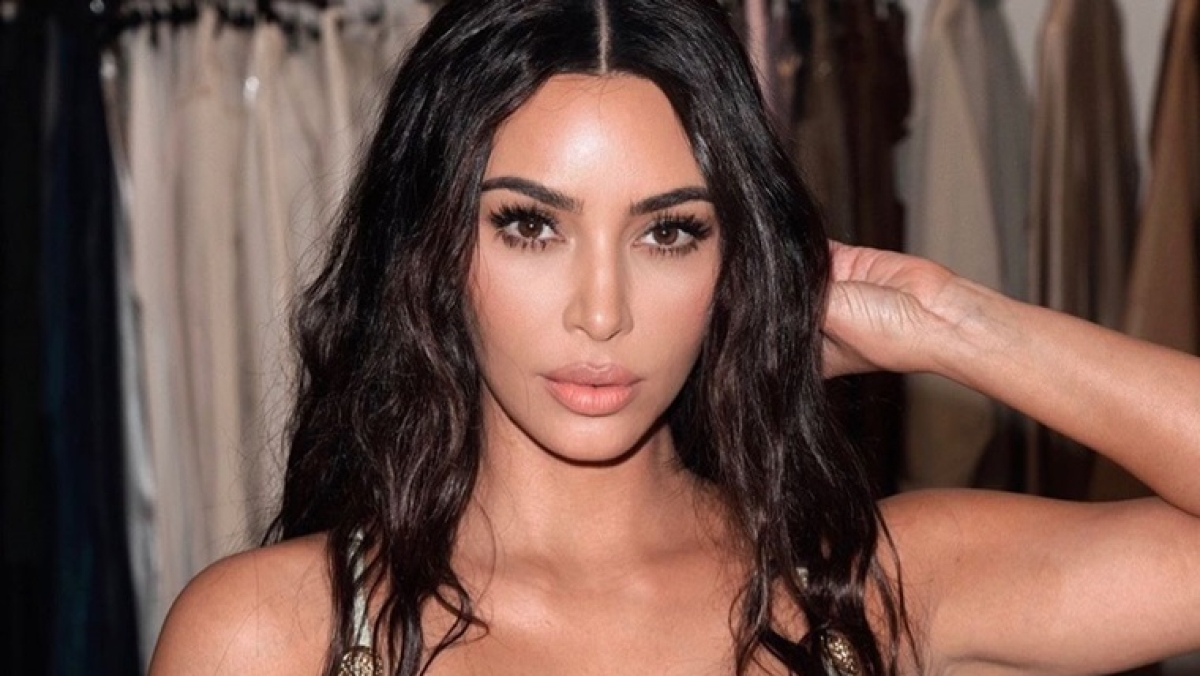 Kim Kardashian shares video of taping up her breasts
