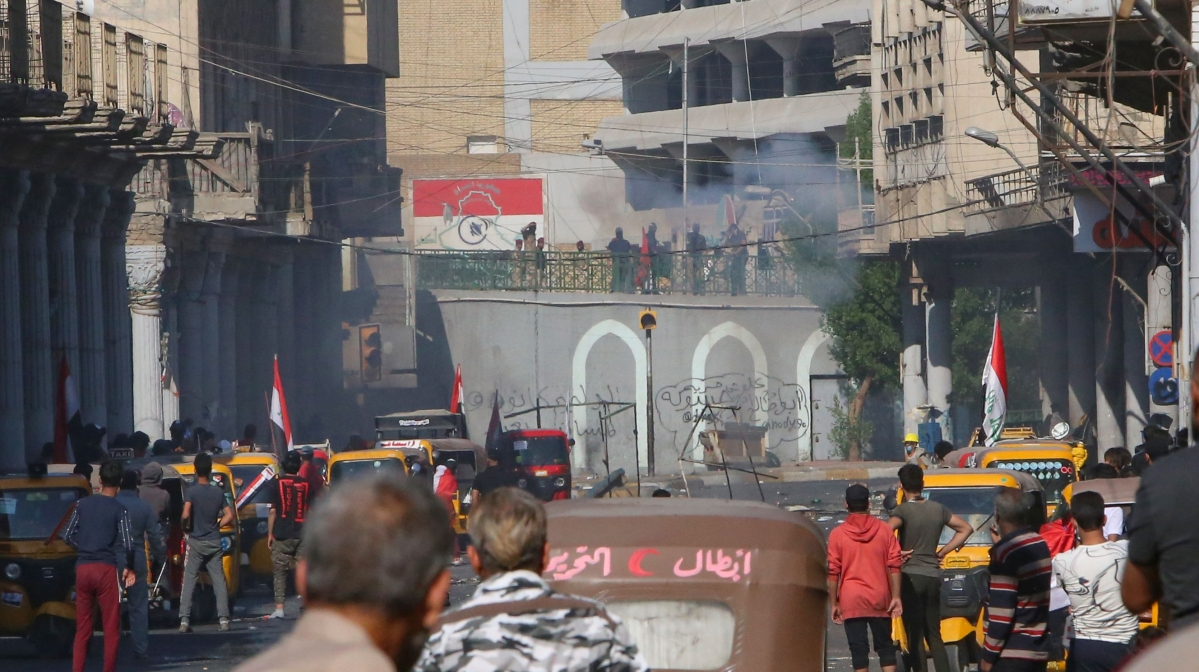 Iraqi security forces fire tear gas canisters to disperse protesters during ongoing anti-government demonstrations in al-Rasheed street in the capital Baghdad on November 9, 2019.