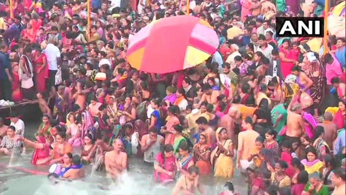 Varanasi: Devotees take early morning dip in Ganges on Kartik Purnima