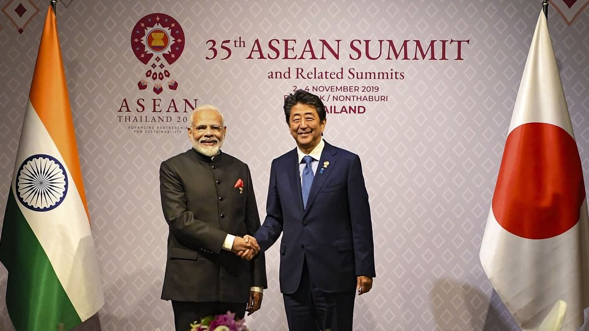 Prime Minister Narendra Modi shakes hands with his Japanese counterpart Shinzo Abe during a bilateral meeting on the sidelines of 16th India-ASEAN Summit, in Bangkok, Thailand, Monday, Nov. 4, 2019.