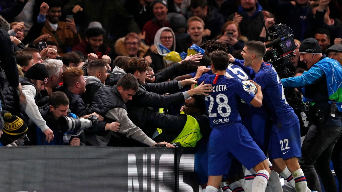 Chelsea's players celebrate with their supporters after making the score 4-4 during the UEFA Champion's League Group H football match between Chelsea and Ajax at Stamford Bridge in London.