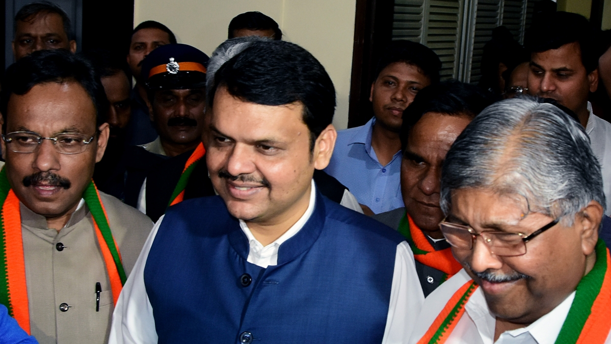 Maharashtra Chief Minister Devendra Fadnavis and Maharashtra BJP state President Chandrakant Patil arrive for a meeting with party supporters and MLAs at the party office in Mumbai on Sunday.