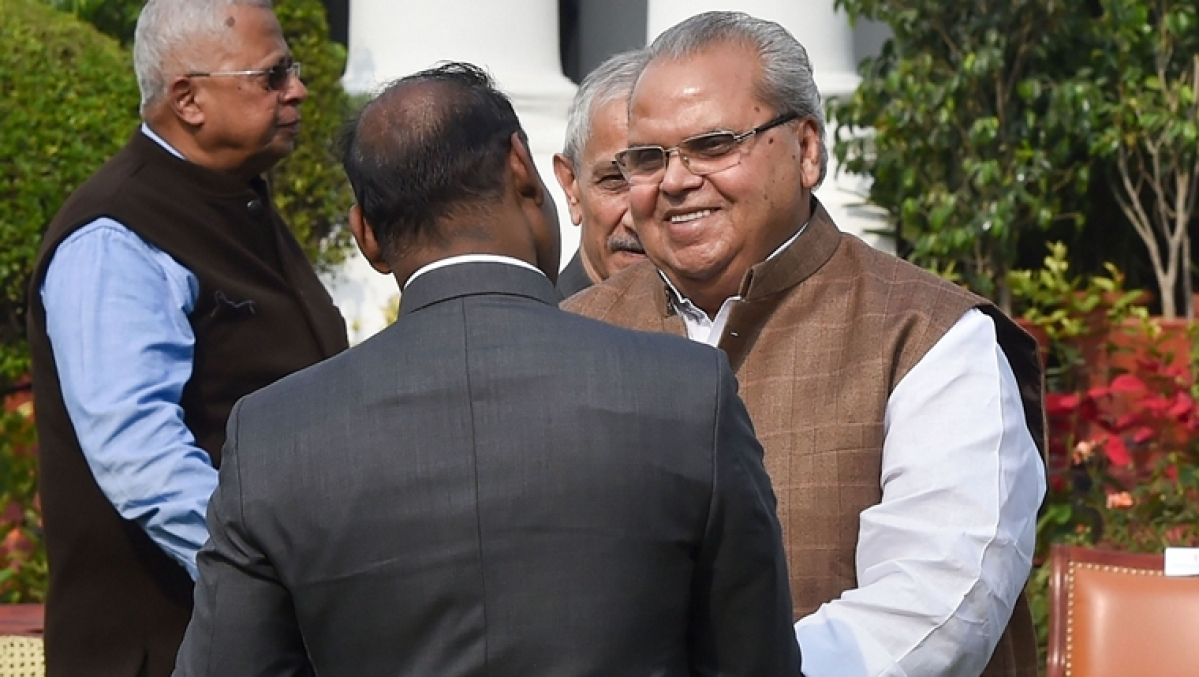 Governor of Goa, Satya Pal Malik with Jammu and Kashmir Lt. Governor Girish Chandra Murmu during the lunch hosted by Vice President Venkaiah Naidu, in New Delhi, Friday, Nov. 22, 2019.