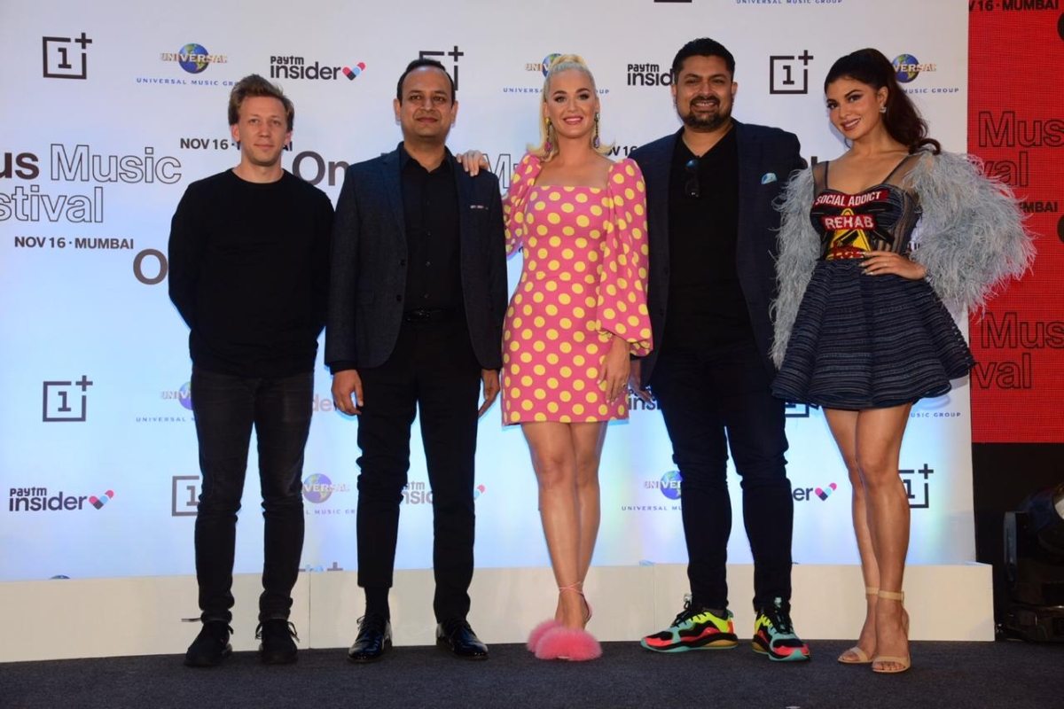 Katy Perry at press conference in Mumbai with organizers and Bollywood actress Jacqueline Fernandez.