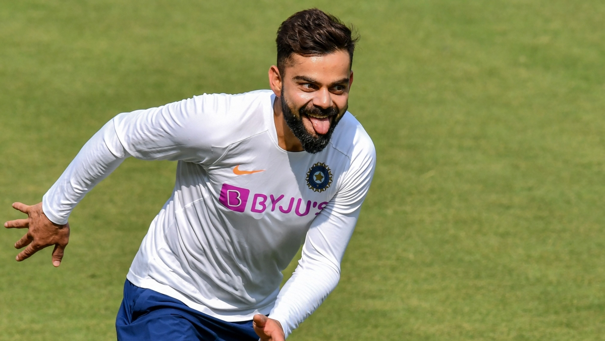 India's captain Virat Kohli reacts after scoring a point during a training session ahead of the first test match between India and Bangladesh at Holkar Cricket Stadium in Indore on November 12, 2019.