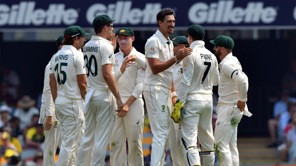Australia's paceman Mitchell Starc (3rd R) celebrates the dismissal of Pakistan's batsman Haris Sohail on day one of the first Test cricket match between Pakistan and Australia at the Gabba in Brisbane on November 21, 2019.