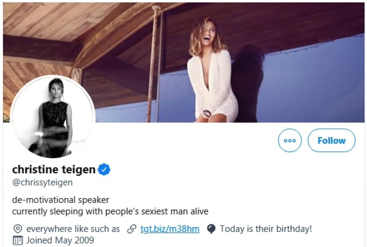 Chrissy Teigen teases John Legend by wearing 'Sexiest Man Alive' onesie on Thanksgiving