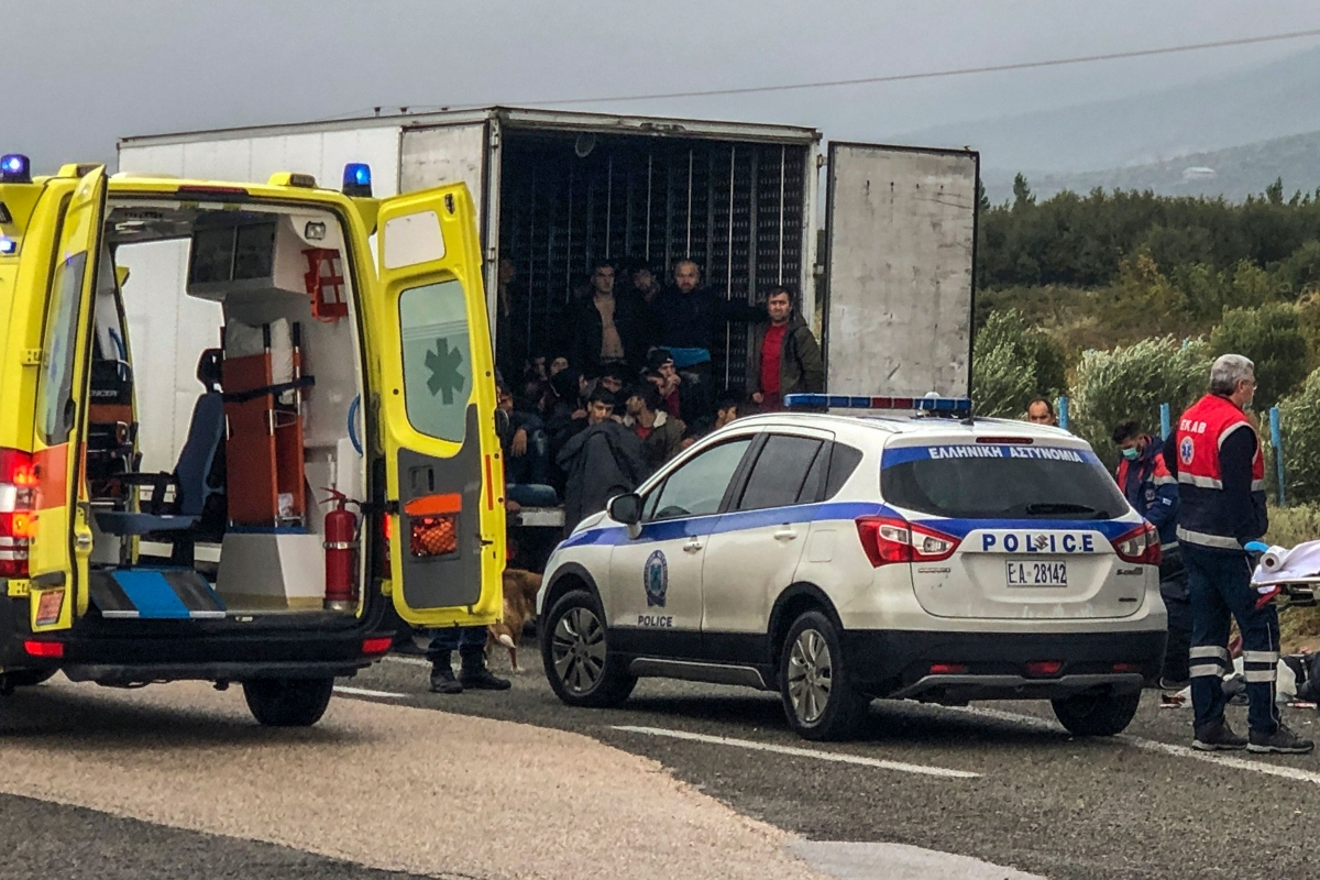 Police and emergency services are at work ti take care of 41 migrants who were found alive in a refrigerated truck near Xanthi, northern Greece, on November 4, 2019.