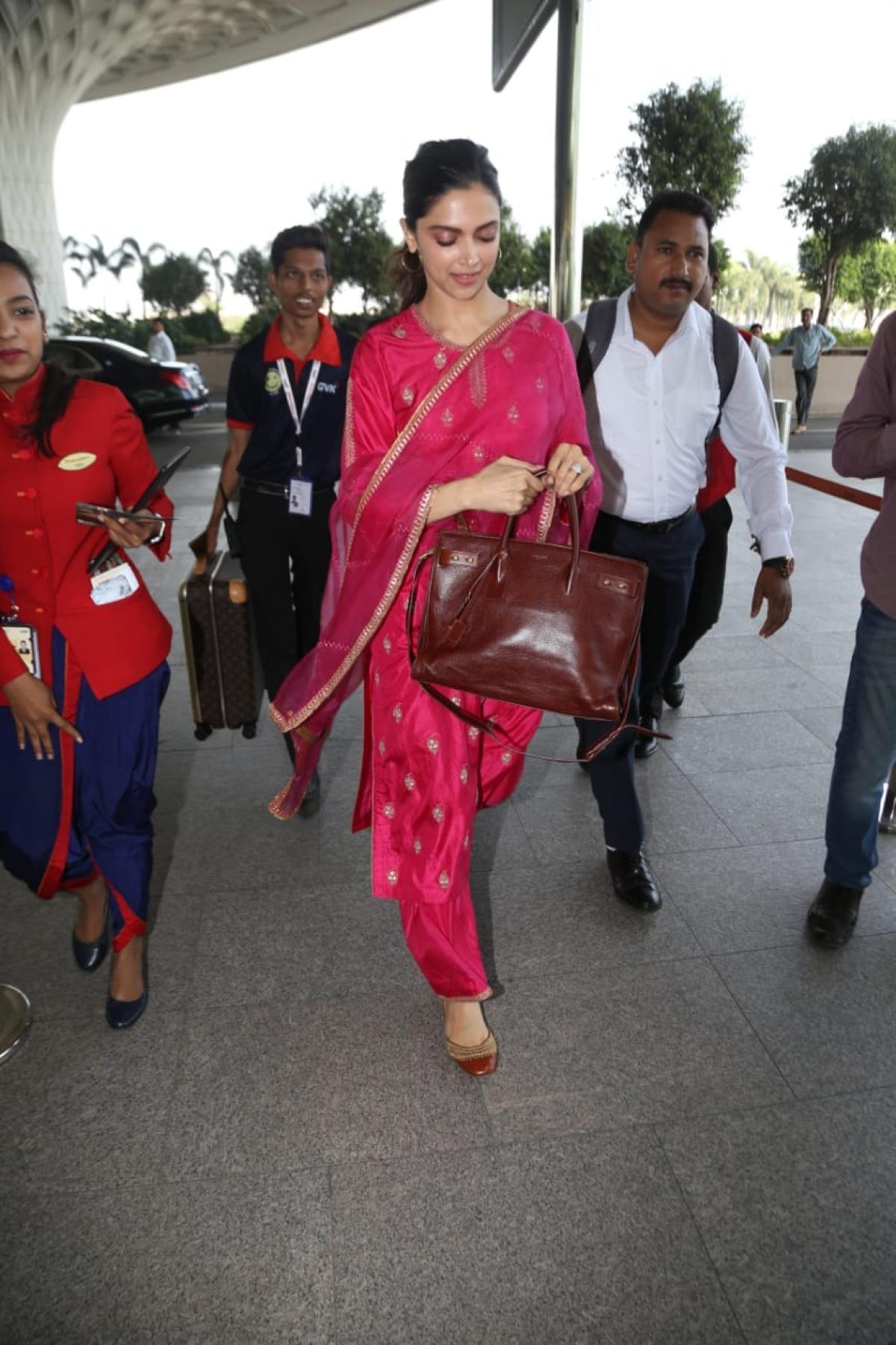 Deepika pairs her royal fuchsia pink salwar suit with Rs 2.7 lakh handbag
