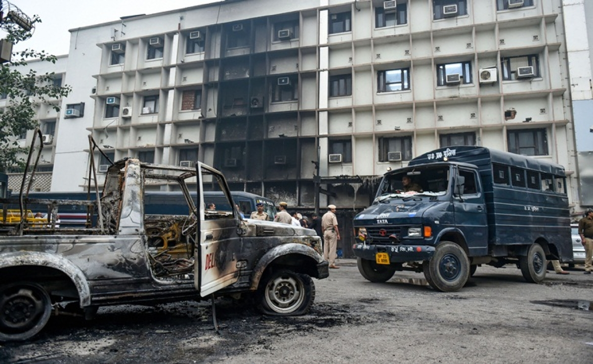 A view of a police vehicle after it was burnt down during clashes between lawyers and police personnel at Tis Hazari Court complex in New Delhi.