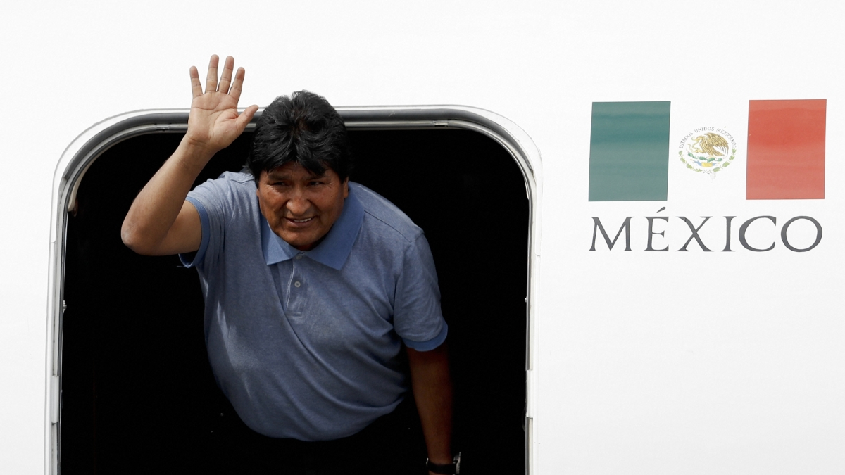Former Bolivian President Evo Morales waves upon his arrival in Mexico City, Tuesday, Nov. 12, 2019.
