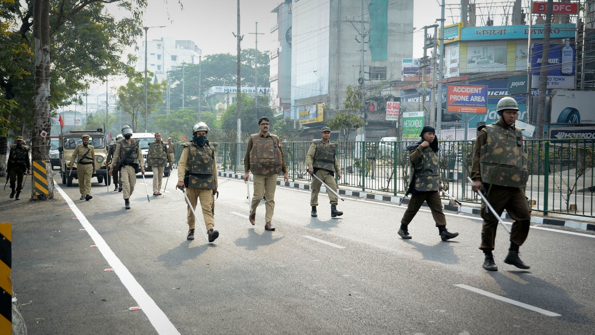 Security personnel patrol a street during curfew a day after unrest against the Citizenship Amendment Bill, at GS Road in Guwahati, Thursday, Dec. 12, 2019.