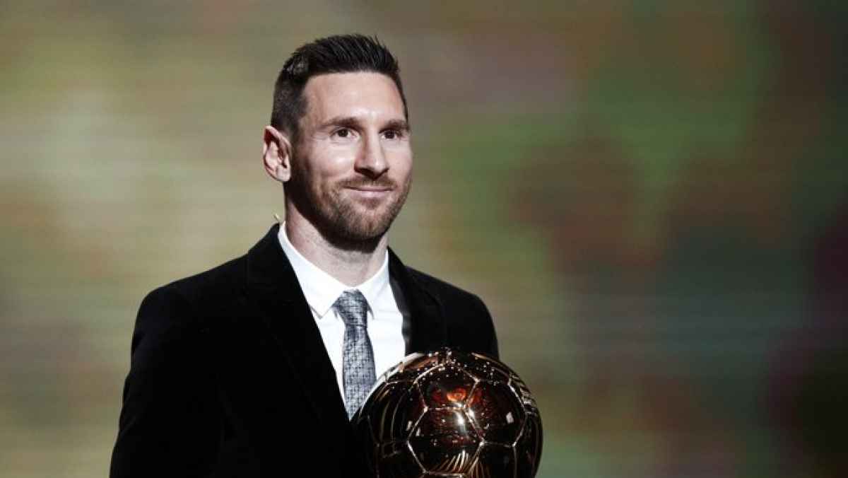 Lionel Messi with the Ballon D'Or