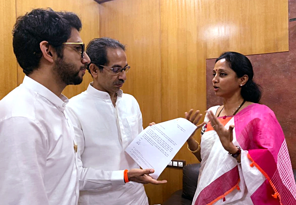 NCP leader Supriya Sule, Chief Minister of Maharashtra Uddhav Thackeray and Shiv Sena leader Aaditya Thackeray pose for a photo during a meeting, in Mumbai on Sunday.