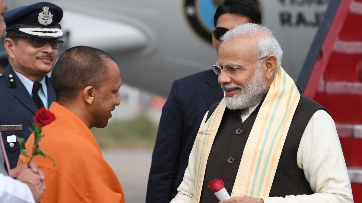 Prime Minister Narendra Modi being received by Uttar Pradesh Chief Minister Yogi Adityanath, on his arrival in Kanpur, Saturday, Dec. 14, 2019.