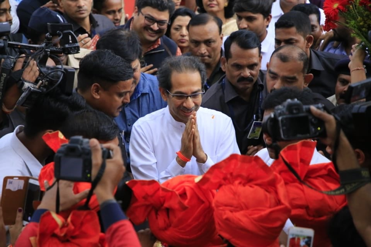 Chief Minister Uddhav Thackeray receives a warm welcome at the Nagpur airport as he arrives for the Winter Session of the Maharashtra State Assembly.