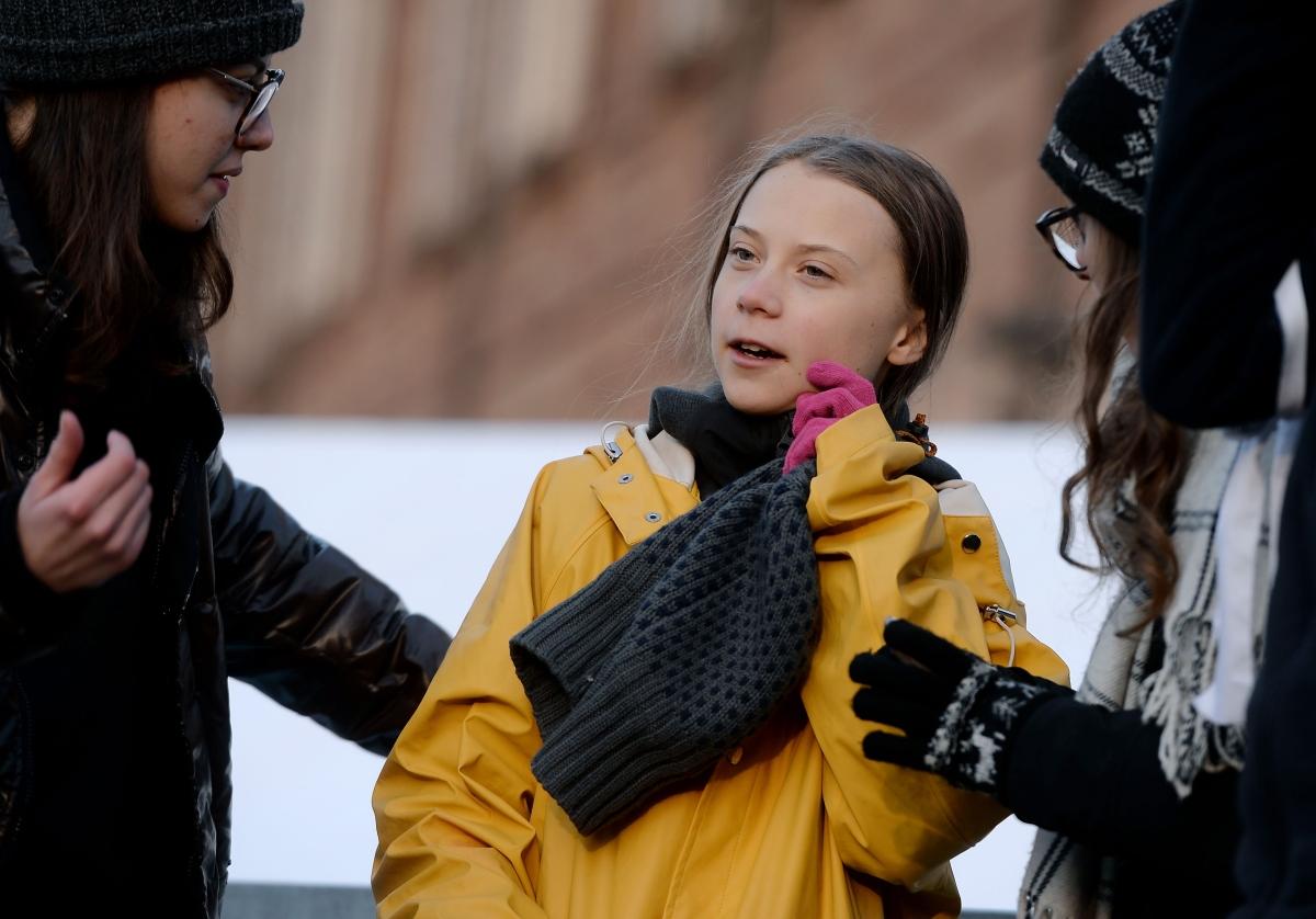 Greta Thunberg apologises for 'against the wall' remark