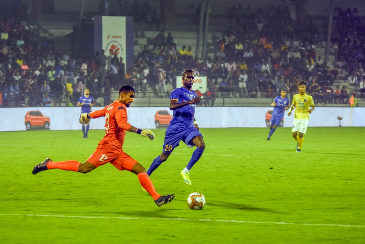 Players of Mumbai City FC (in blue) and Kerala Blasters FC (in yellow) vie for ball during ISL Football Match, at Andheri Sports Complex in Mumbai, Thursday, Dec. 5, 2019.