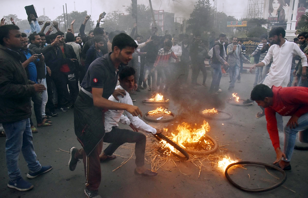 College students burn an effigy of Prime Minister Narendra Modi during a protest against the Citizenship Amendment Bill (CAB), in Patna on Thursday