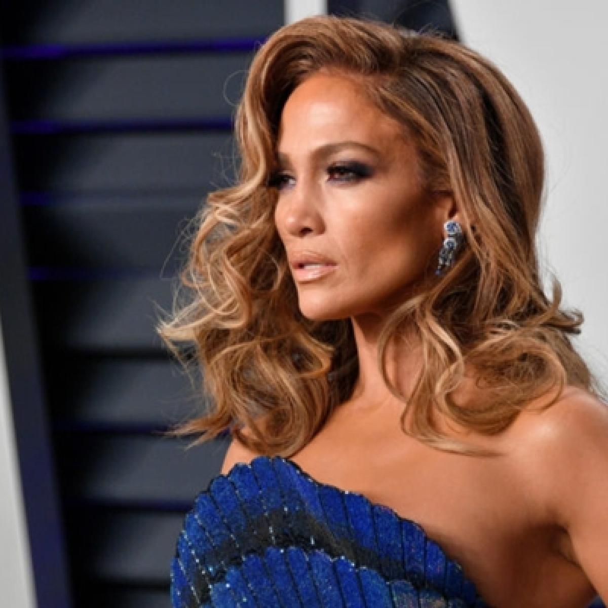 Jennifer Lopez, 50, sets the internet ablaze as she flaunts her toned body in a white bikini