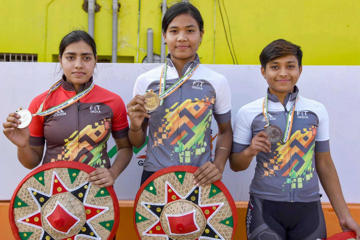 Kanrup: Gangotri Bodoloi of Assam (c), Swasti Singh of Odisha (L) and CHayanika Gogoi of Assam pose with their medals after the culmination of finals of U-21 60 Km cycling race in Khelo India Youth Games on Monday.