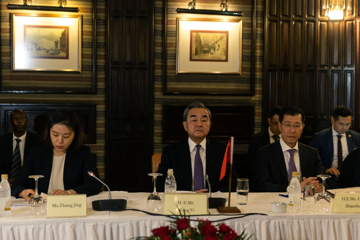 Chinese Foreign Affairs Minister Wang Yi (C) sits with his delegation during a bilateral meeting with his Zimbabwean counterpart Sibusiso Moyo in the capital Harare on January 12, 2019 during an official visit.