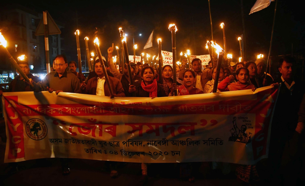 Activists of Asom Jatiyatabadi Yuba Chatra Parishad (AJYCP) take part in a torch light procession during a protest against Citizenship Amendment Act (CAA), in Guwahati on Saturday.