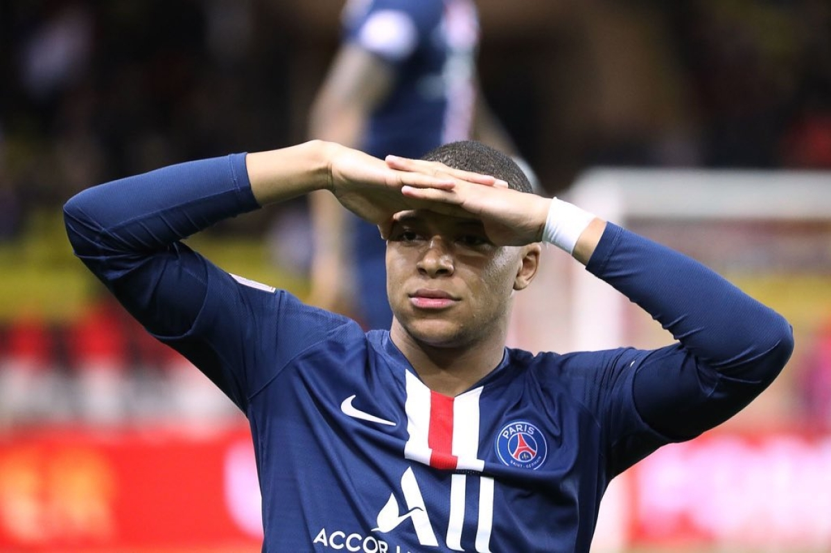 Too fast? After defenders, Kylian Mbappe outruns coronavirus