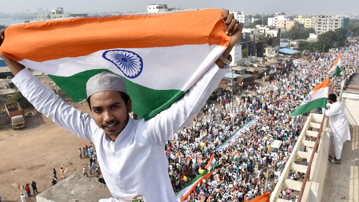A demonstrator holding the national flag during a Tiranga rally to protest against CAA, NRC and NPR in Hyderabad.