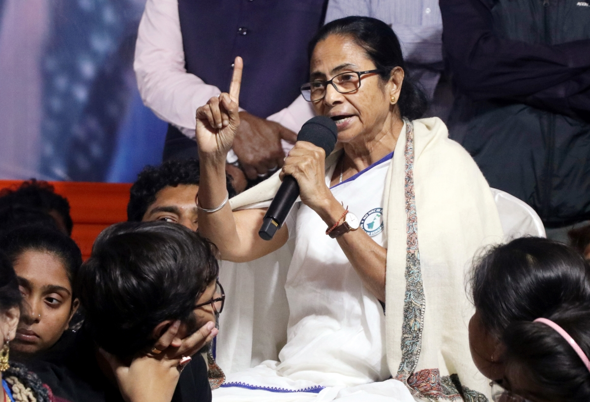 West Bengal Chief Minister Mamata Banerjee along with TMCP activists during dharna to protest against CAA, in Kolkata on Tuesday.