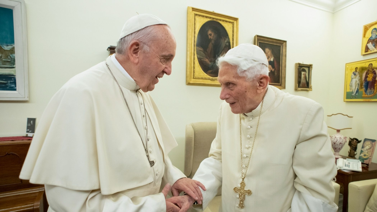 Pope Francis (L) meeting with retired Pope Benedict XVI (R) at the Vatican.