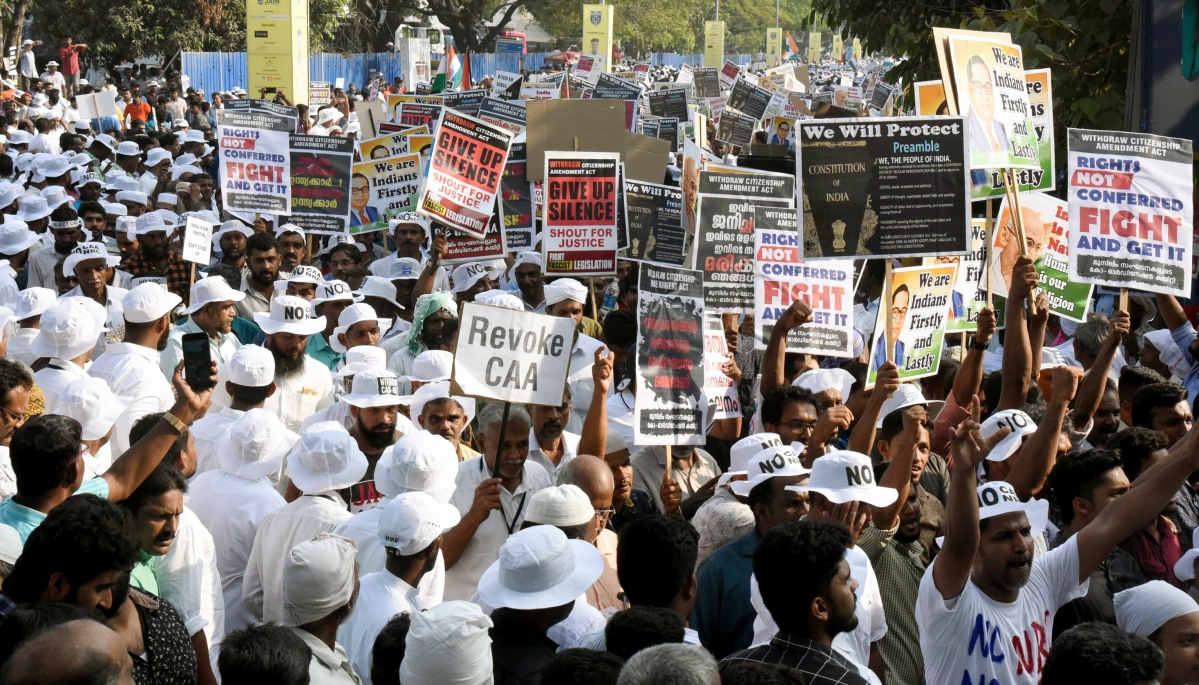 Members of the Muslim Community hold placards and shout slogans during a protest against the Citizenship Amendment Act 2019, in Kochi.