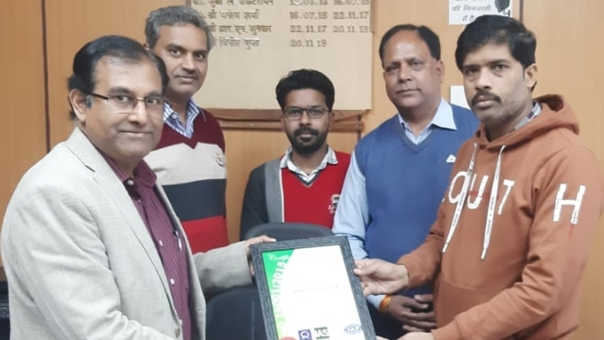 DRM Vineet Gupta, receiving ISO. 14001: 2015 certificate for Indore railway station by the representative of the ISO at his office in Ratlam on Thursday. On this occasion, additional DRM KK Sinha and Kamal Singh Chaudhary senior divisional engineer were also present.