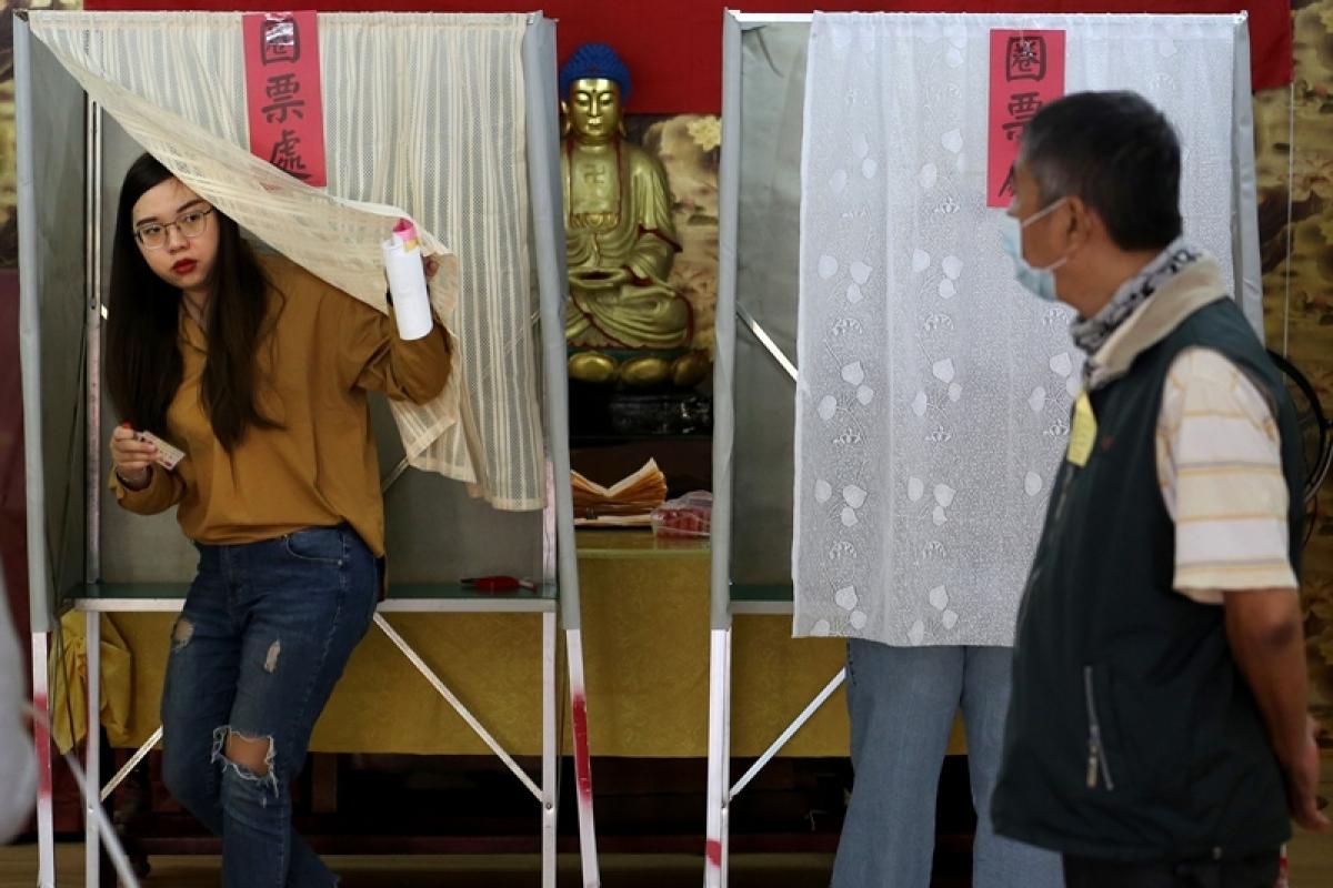 Voting begins for Taiwan leadership, legislature elections